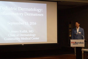 Dr. Avery Kuflik giving a pediatric lecture to the pediatric department at Community Medical Center